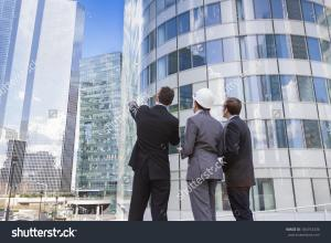 stock-photo-businessmen-and-architect-team-outdoors-planning-construction-project-with-office-buildings-184753436