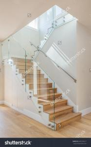 stock-photo-glass-staircase-custom-home-build-487322617