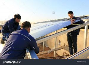 stock-photo-luannan-december-engineering-and-technical-personnel-to-install-solar-photovoltaic-605926592