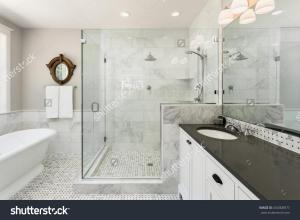 stock-photo-master-bathroom-in-new-luxury-home-bathtub-and-shower-with-tile-and-glass-shower-doors-450308977