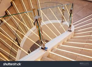 stock-photo-modern-curved-white-marble-stairs-with-glass-railing-404300890