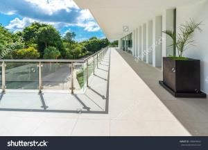 stock-photo-perspective-of-the-modern-glass-and-steel-balcony-deck-patio-promenade-railing-exterior-188469842